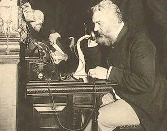 Graham Bell and his telephone, circa 1877